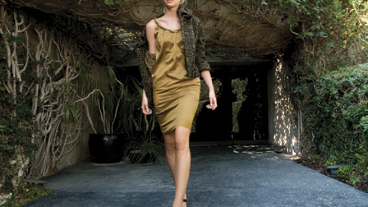 Quantum of Solace - Gold silk charmeuse dress with twisted silk neckline detail and gold and olive bouclé structured jacket from InSanity at Denise Robergé (opening November) on El Paseo.