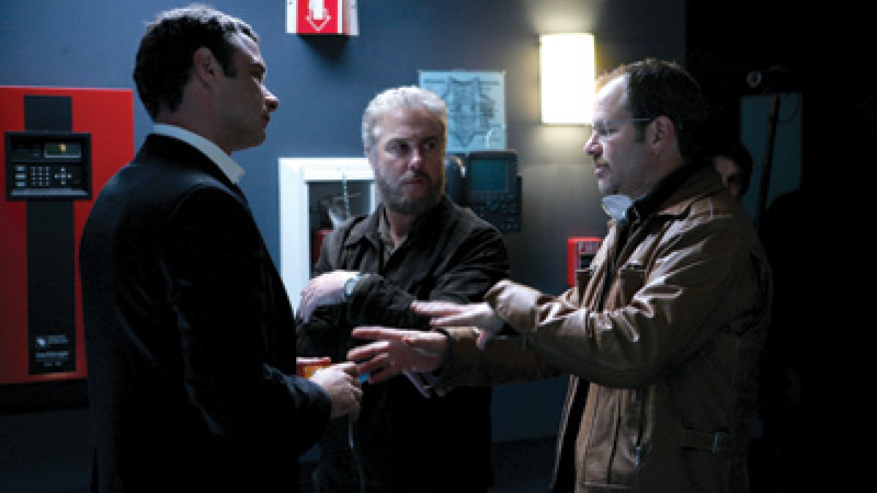 Richard Lewis (right), on the set of CSI in 2007, consults with guest star 