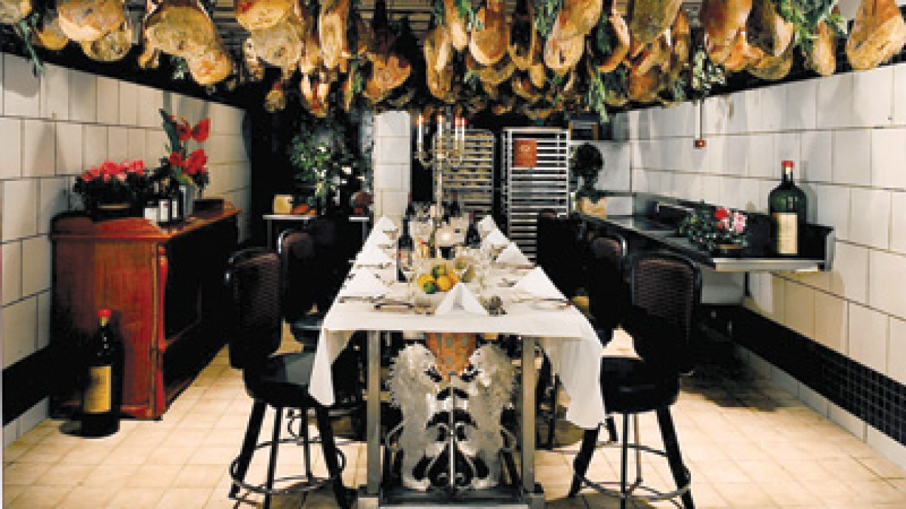 House-cured prosciutto hangs in one of North Beach Restaurant's three private dining rooms.