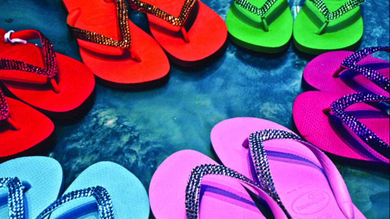 Slip into candy-colored flip flops from Blonde at The River.