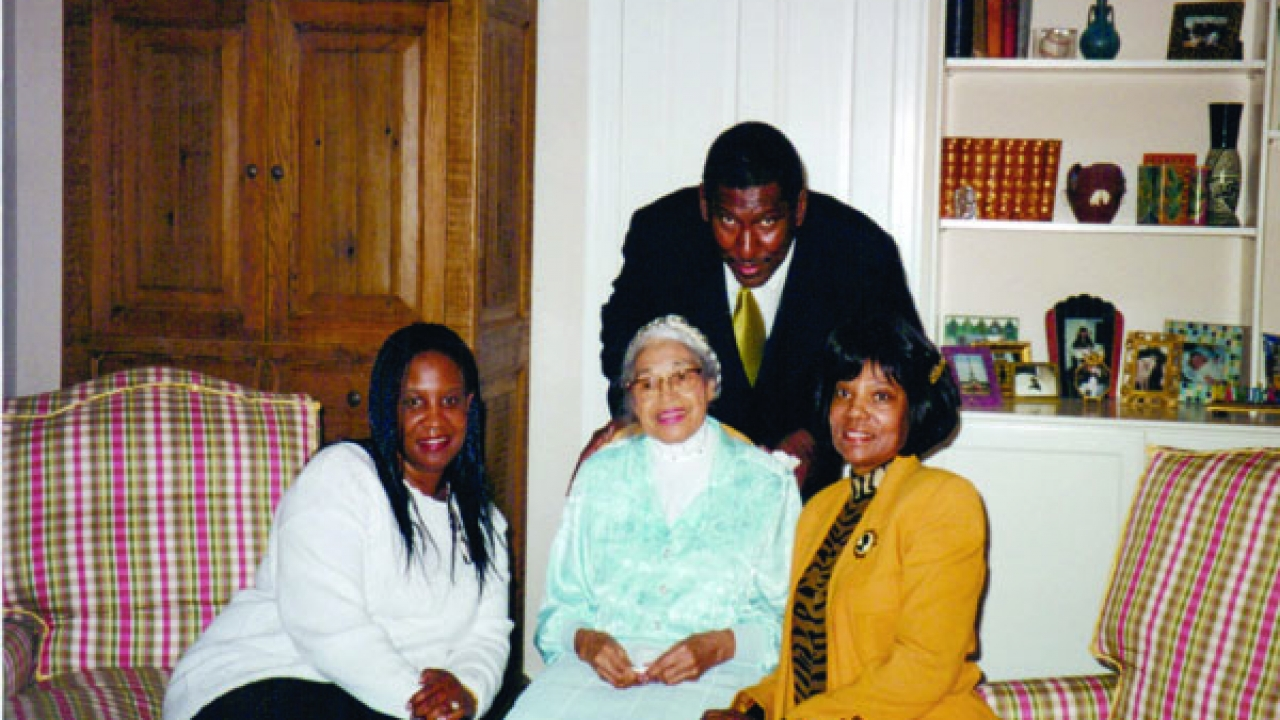 Willis Edwards (standing), Pearl Taylor-Devers, Rosa Parks, and Elaine Steel celebrating signing the deal with CBS for The Rosa Parks Story.