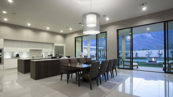 the kitchen has two islands   u201cone has a sink and prep area the other has the wine coolers and is perfect for staging a meal u201d says poon  monte sereno palm springs balances midcentury with spanish tuscan      rh   palmspringslife com