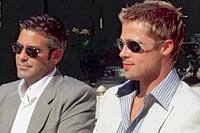 George Clooney and Brad Pitt soak up the Palm Springs Sunshine in Ocean's Eleven.