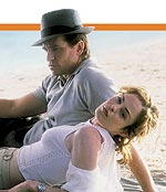 Val Kilmer and Chandra West relax on the beach of The Salton Sea.
